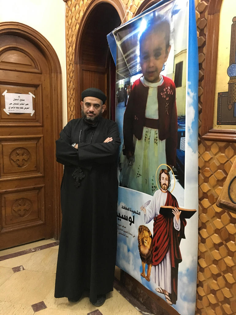 Fr Kyrillos Fathy standing in church dedicated to church bomb victim Lucinda